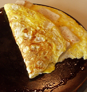eggs (omelette) on a cast iron griddle